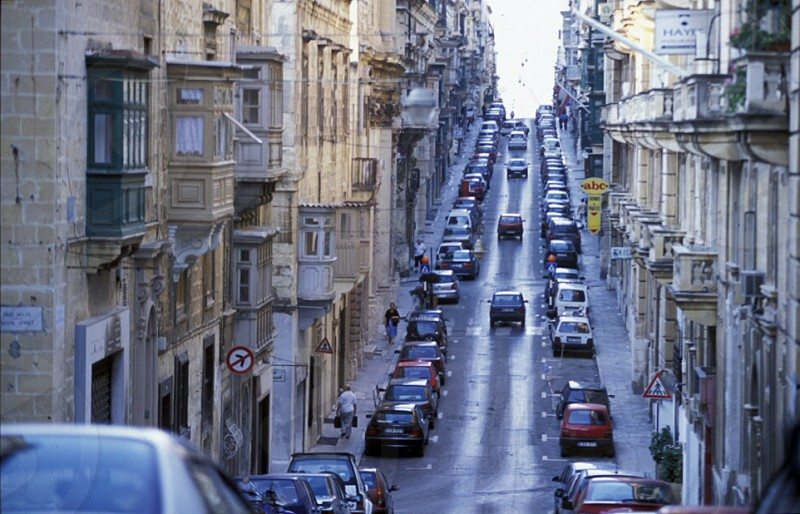 A smal road in the centre of the Old Town of the city of Valletta on the Island of Malta in the Mediterranean Sea in Europe. photo
