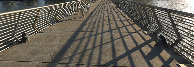 Shadows on the pier photo