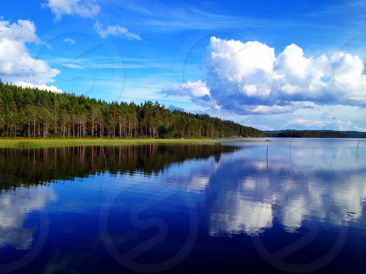 Cloud clouds mirror reflection water lake landscape nature forest dalarna Sweden sea bay summer  photo
