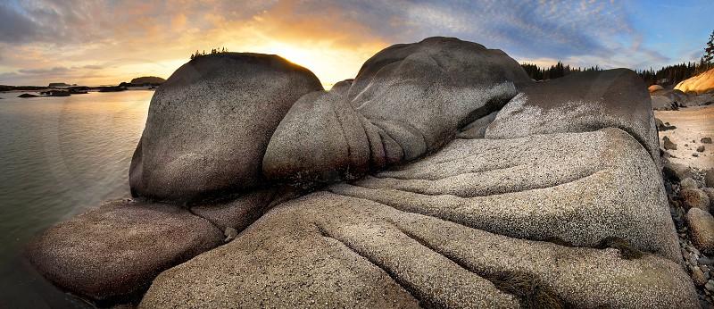 bedrock ledge rock grooves barnacles granite abstract sunset beach rocky coast rocky shore Maine Maine coast Maine shore. photo