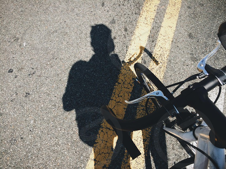 person riding bicycle silhouette photo