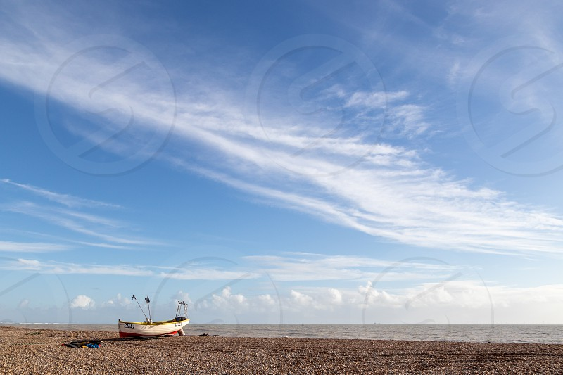 WORTHING WEST SUSSEX/UK - NOVEMBER 13 : View of a fishing boat on the beach in Worthing West Sussex on November 13 2018 photo