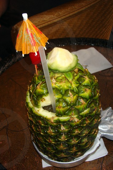 Tropical cocktail in a pineapple photo