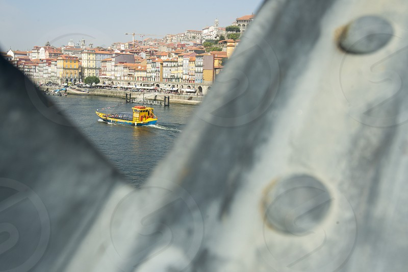 the Ponte de Dom Luis 1 on the Douro River in Ribeira in the city centre of Porto in Porugal in Europe. photo