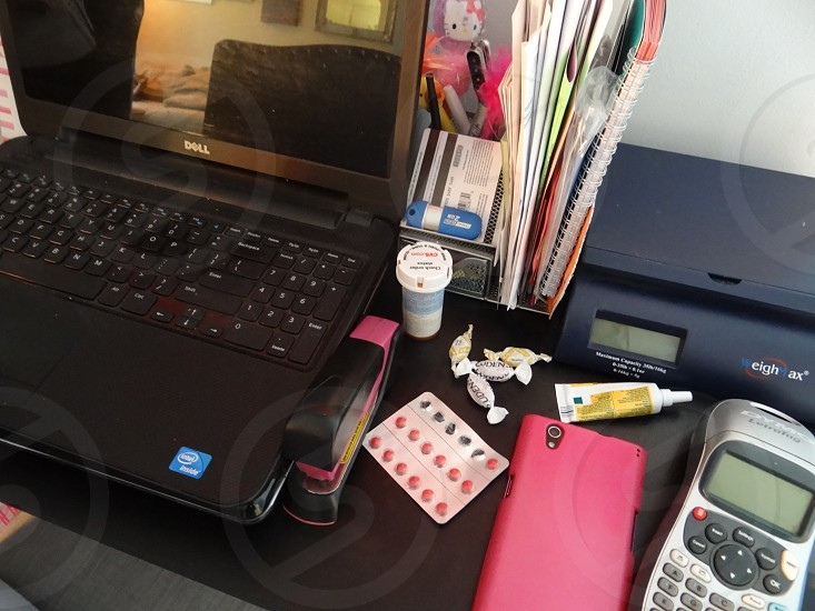 Work space of a person attempting to finish a job even though they are not feeling well. photo