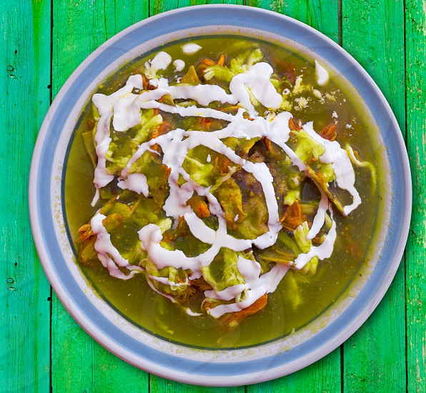 Chilaquiles verdes green recipe from Mexico photo