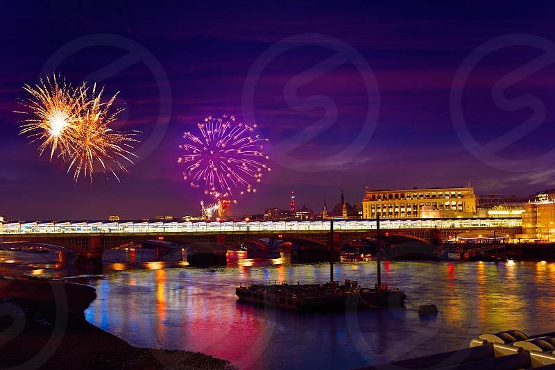London skyline sunset fireworks on Thames river reflection at UK photo