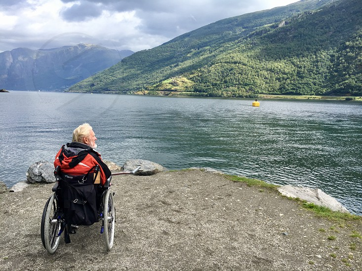 Disabled man in Norwegian fjord photo
