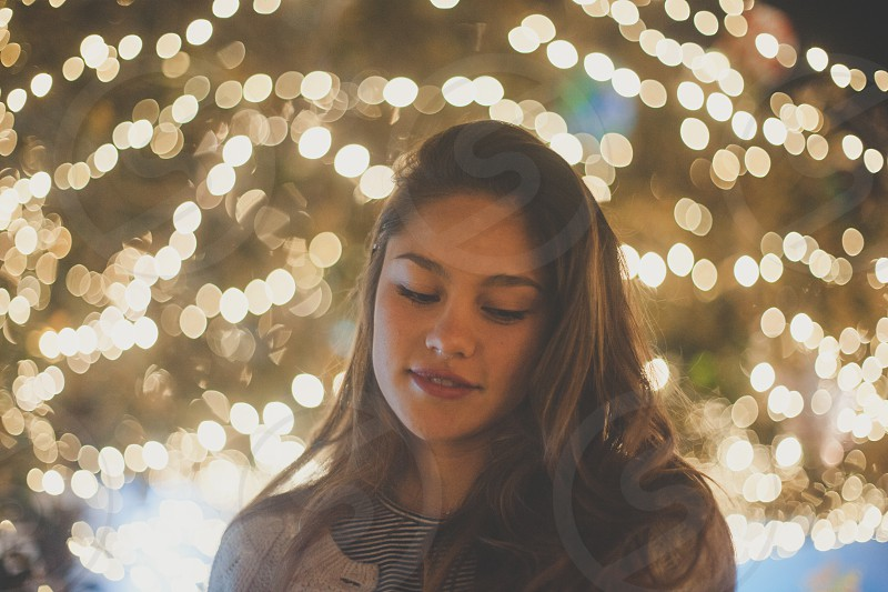 woman standing near christmas tree photo