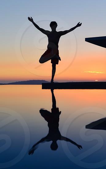 meditation summit peak sunset reflect man reflection water yoga photo