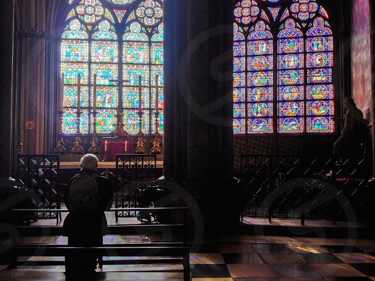 Old man church pray notre-dame paris photo