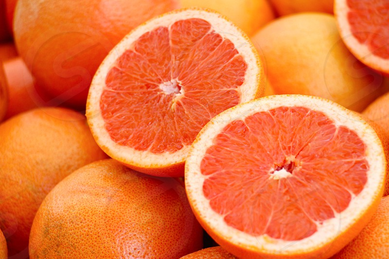 close up photo of whole and sliced oranges photo