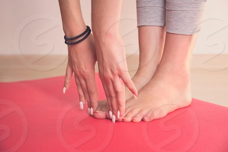 Teen Girl Stretching on Red Yoga Mat Closeup photo