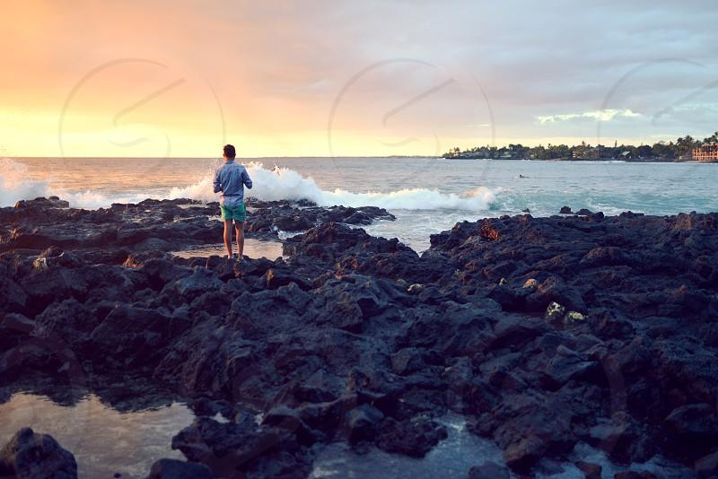 hawaii explore waves surf beach ocean lava rock sunset photo