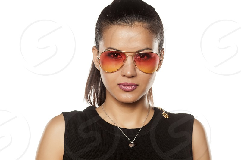 beautiful young woman with sunglasses photo