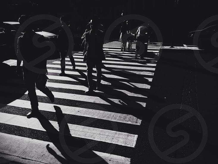 people walking on crosswalk photo