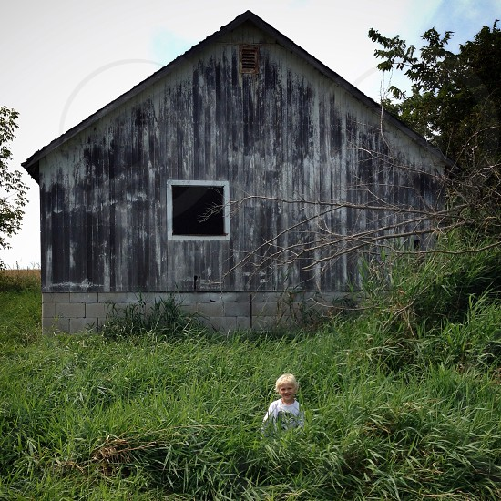 boy in front of abandoned house photo