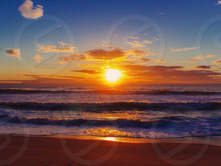 sunset view across the sea shore photo