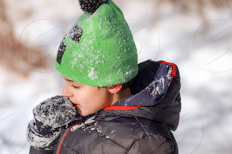 Winter; warm; boy; snow; hat; mittens photo