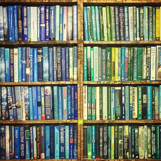books on brown wooden shelf photo