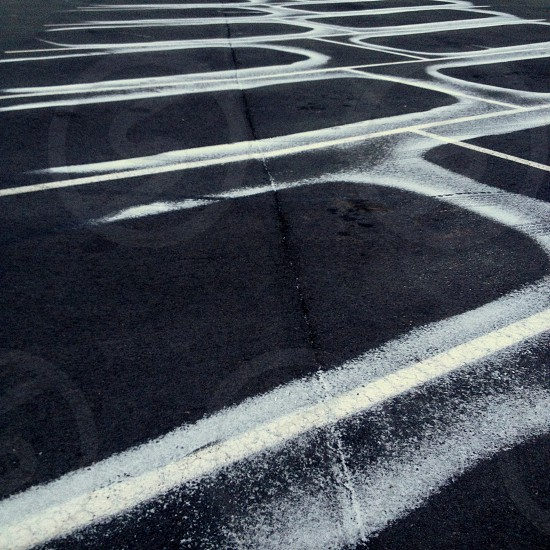 Snow drift patterns on parking lot photo