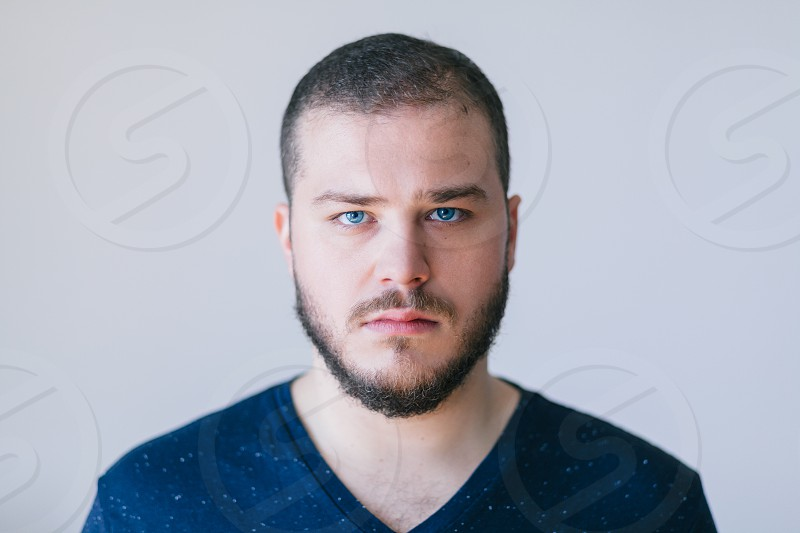 Portrait of a handsome bearded young man photo