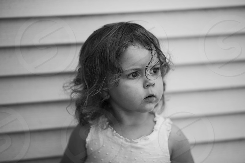 girl wearing a white dot tank top photo