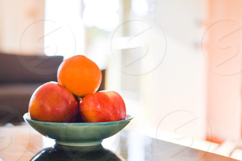 bowl fruit food orange apple light photo