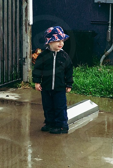 Rain boy hat bucket hat toddler San Diego California rain happy smiling young child sweet photo
