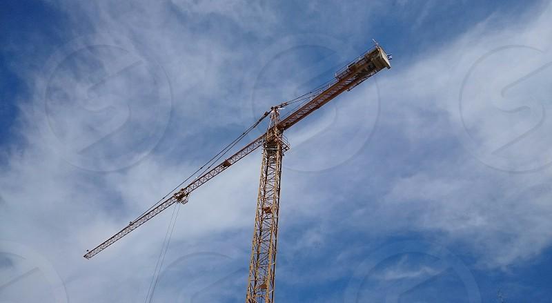 crane building sky view point shot blue cloudy metal yellow ordinary photo