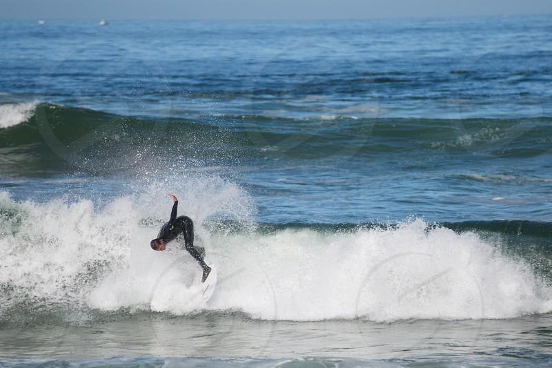 surfer rides a wave photo