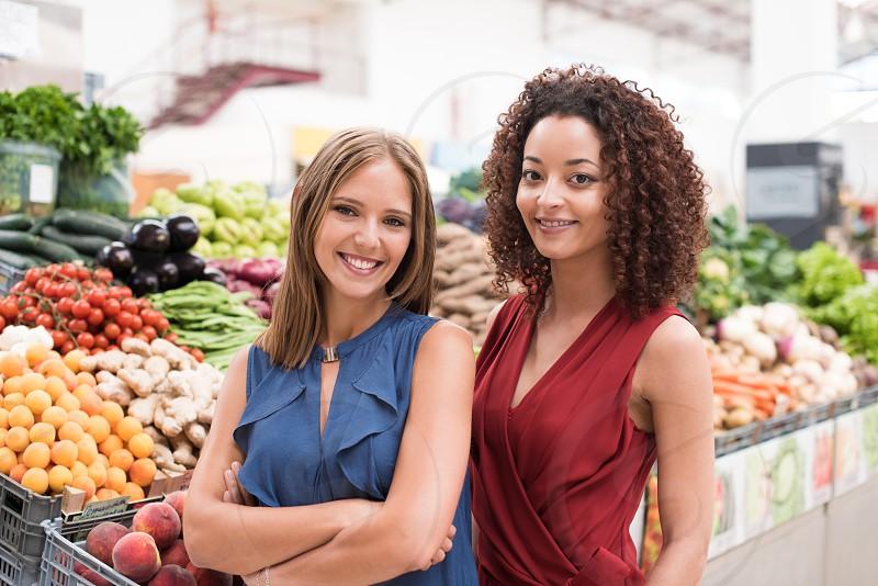 women business farmer market greengrocer fruits vegetables bio organic photo