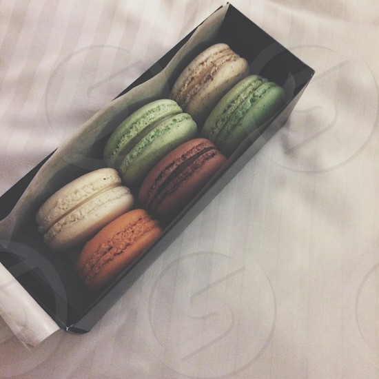6 french macarons in black paper box photo