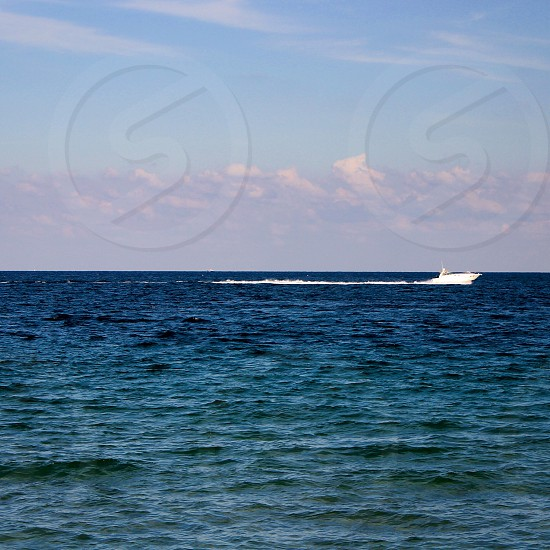 white powerboat in the ocean photo