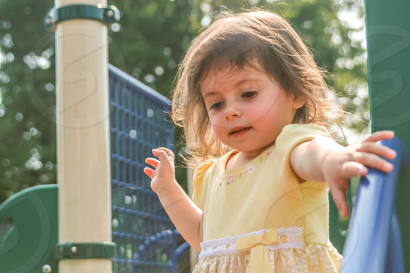 Young girl at the playground photo