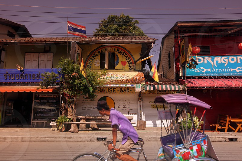 a road in the old town of the city of Chiang Rai in the north provinz of chiang Rai in the north of Thailand in Southeastasia. photo
