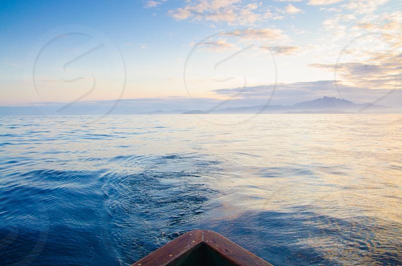 The bow of an Alaskan fishing boat heading toward the fishing grounds. photo