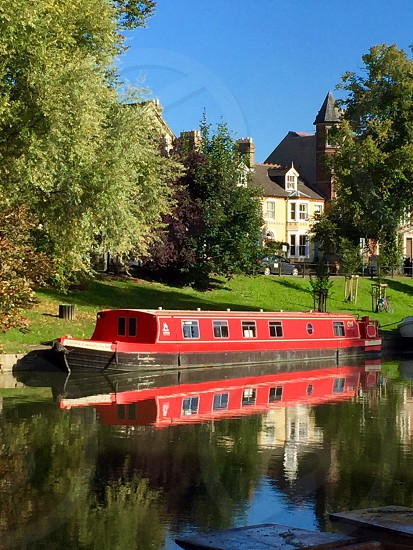 Cambridge England travel boat river grass outside scenic historic reflection water glass red transport trees photo