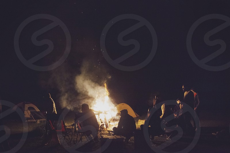 people camping with bonfire photo