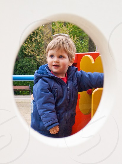boy with blonde hair in blue jacket photo