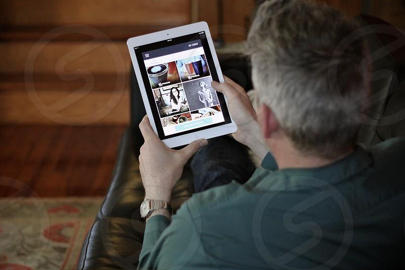man using tablet photo