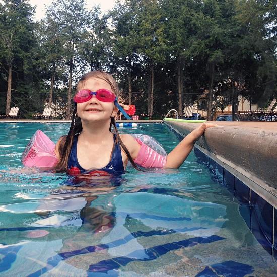 girl wearing blue leotard in swimming pool photo