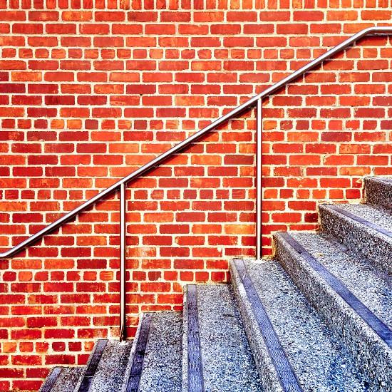 Stairs bricks bannister brick wall  photo