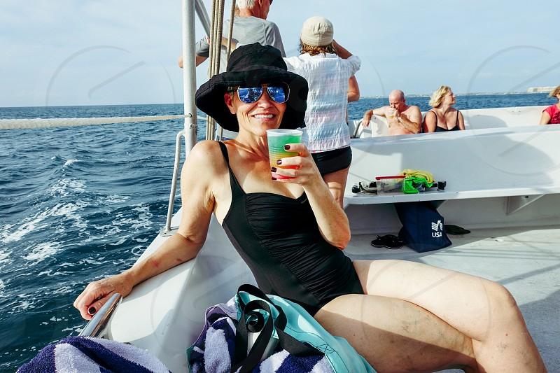 Catamaran boating cruising tour Aruba stop snorkeling alcohol drink party  photo