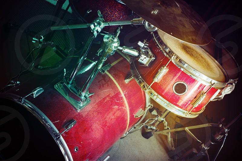 Old dusty drum kit in dark room.  photo