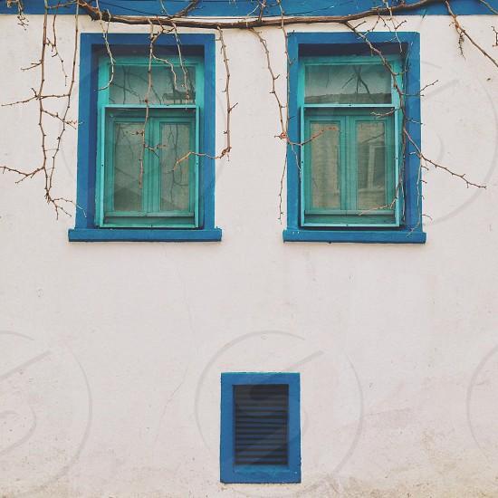 blue framed window photo