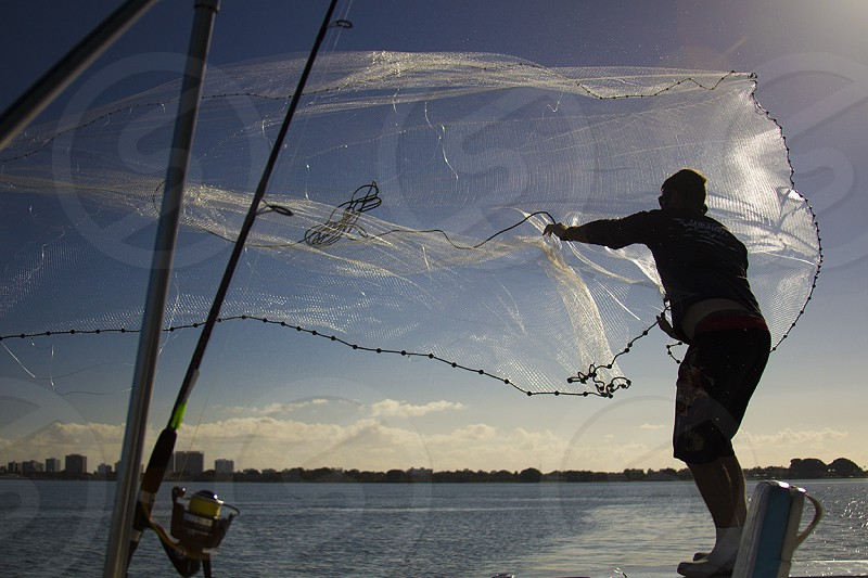 fisherman throwing net on sea time lapse photography photo