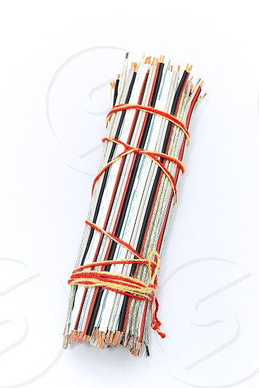 """Topic:""""Bundle of Wires"""" 3  This is an image of a bundle of electronic wires in multiple colors tied up with string with copy space and a clean white background. photo"""