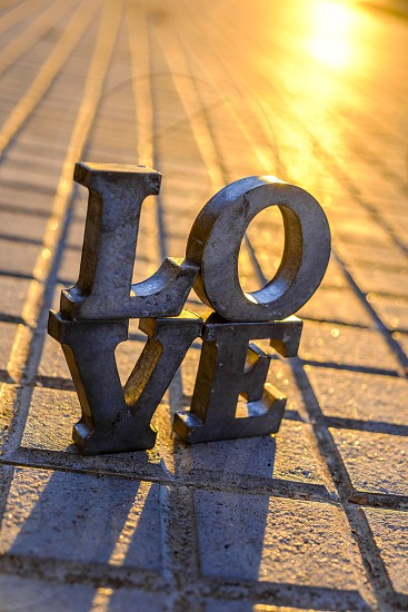 Love sign with metal letters in a street of Spain photo