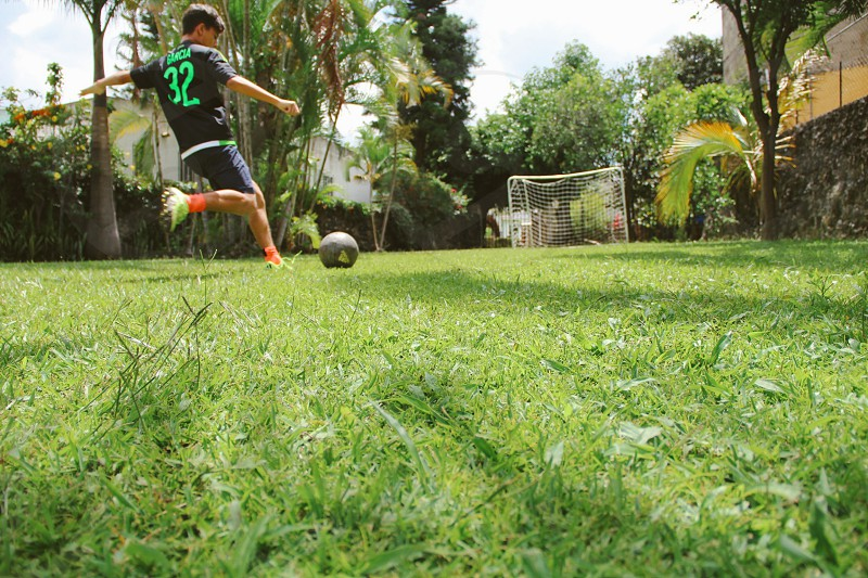 Soccer football player fun weekend garden photo